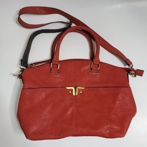 Burnt orange leather purse by Bueno
